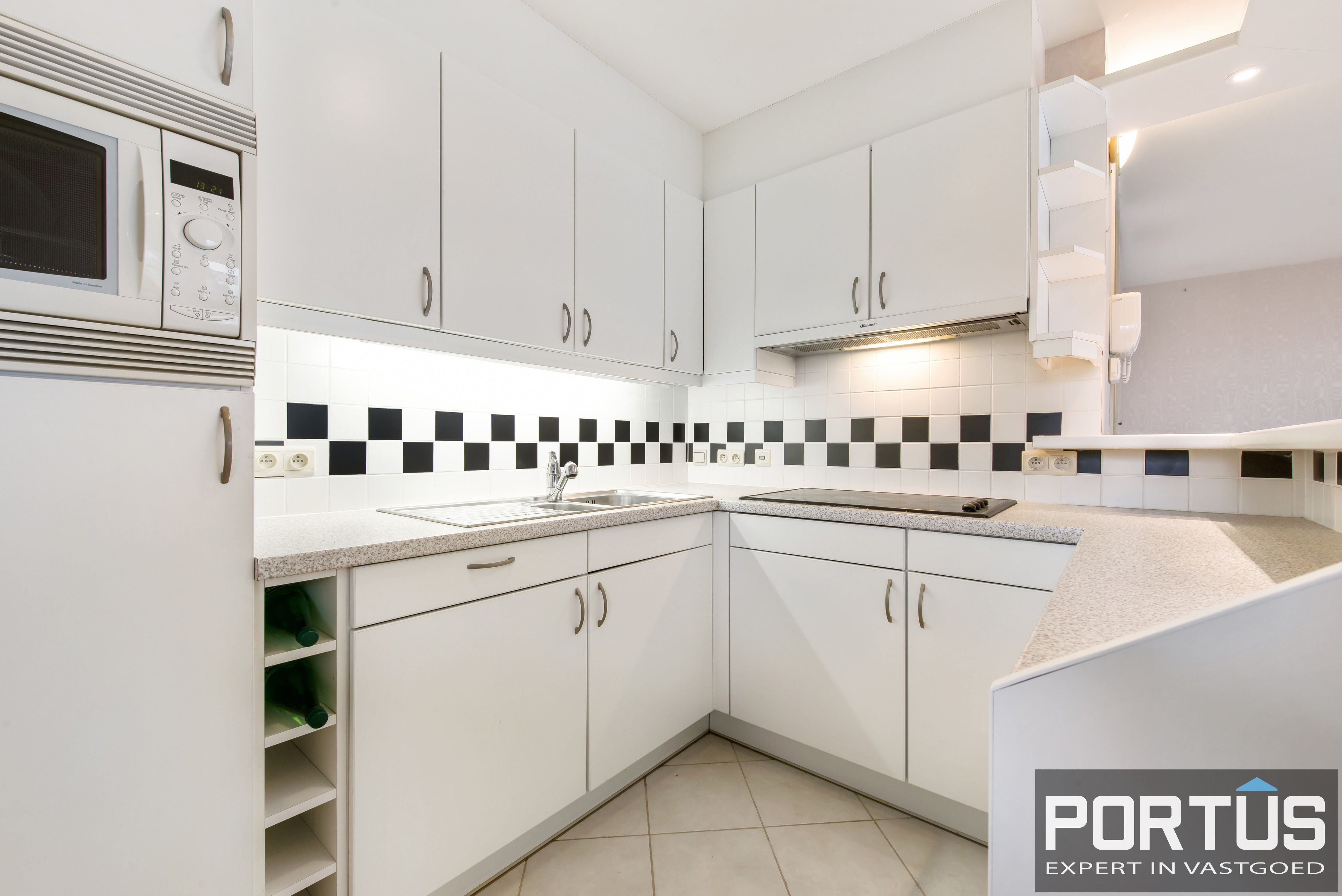 Zongerichte appartement met 2 slaapkamers te koop te Nieuwpoort - 10892