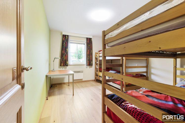 Gelijkvloers appartement te koop met 2 slaapkamers en privé tuin - 9840